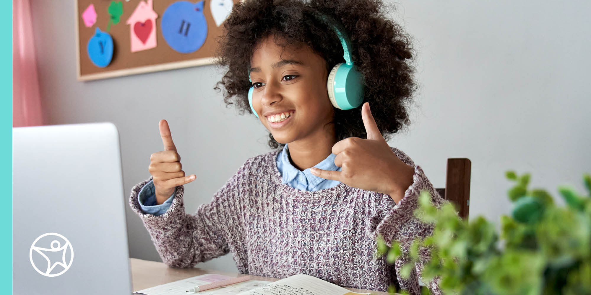 African American girl using sign language in front of a computer