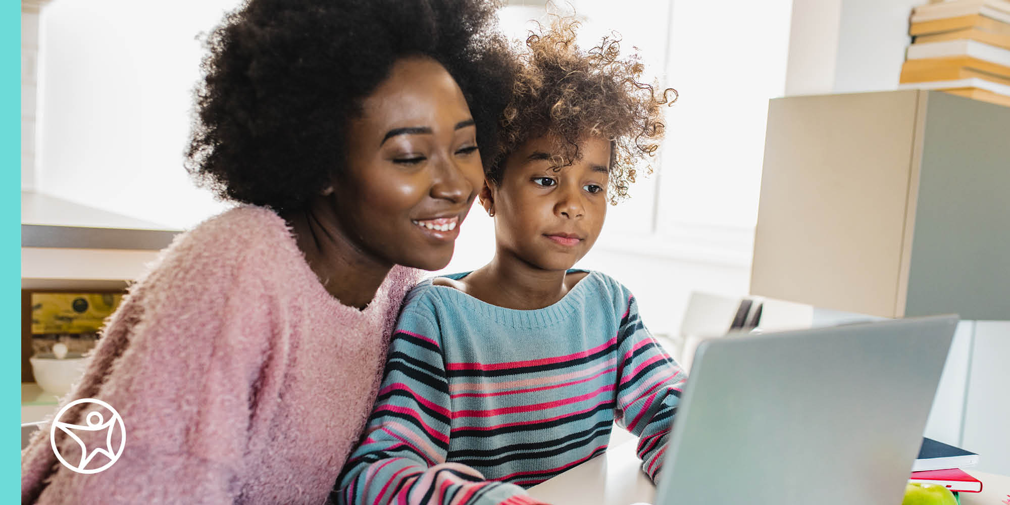 African American mother and daughter learning in front of a laptop computer